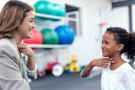 Speech Language Pathologist working with child